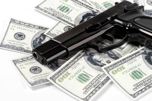 Gun laying on top of money